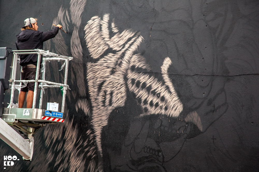 South African street artist Sonny at work on a mural in Waterford Ireland.
