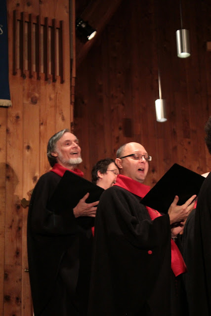 David Rain, Tenor - and composer of The Rideau Carol - stands to the left of the choir