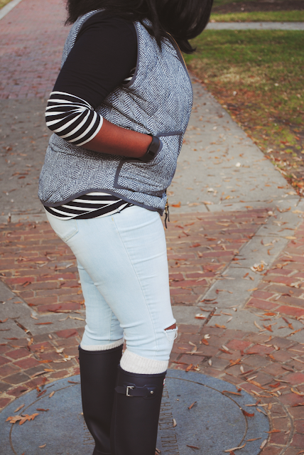 An outfit inspiration post featuring a J. Crew Factory herringbone vest, J. Crew shirt, and tall navy Hunter boots.