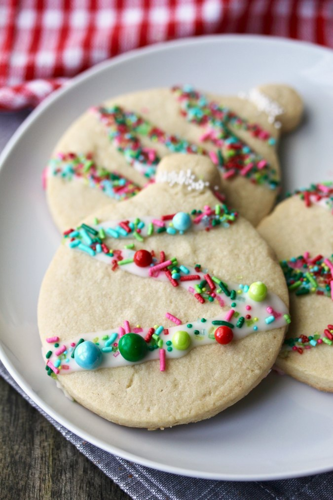 Cut out Christmas Ornament Cookies with sprinkles