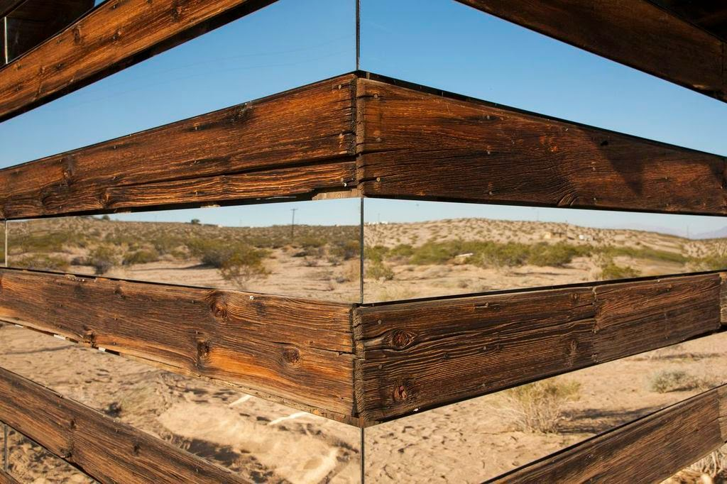 Phillip replaced every other board with horizontal mirrors… - This Is What Happens When You Put Rows of Mirrors on a Shack in the Desert