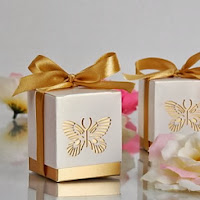 http://www.specialgiftboxes.com/product/gold-laser-cut-butterfly-favor-box-set-of-12/
