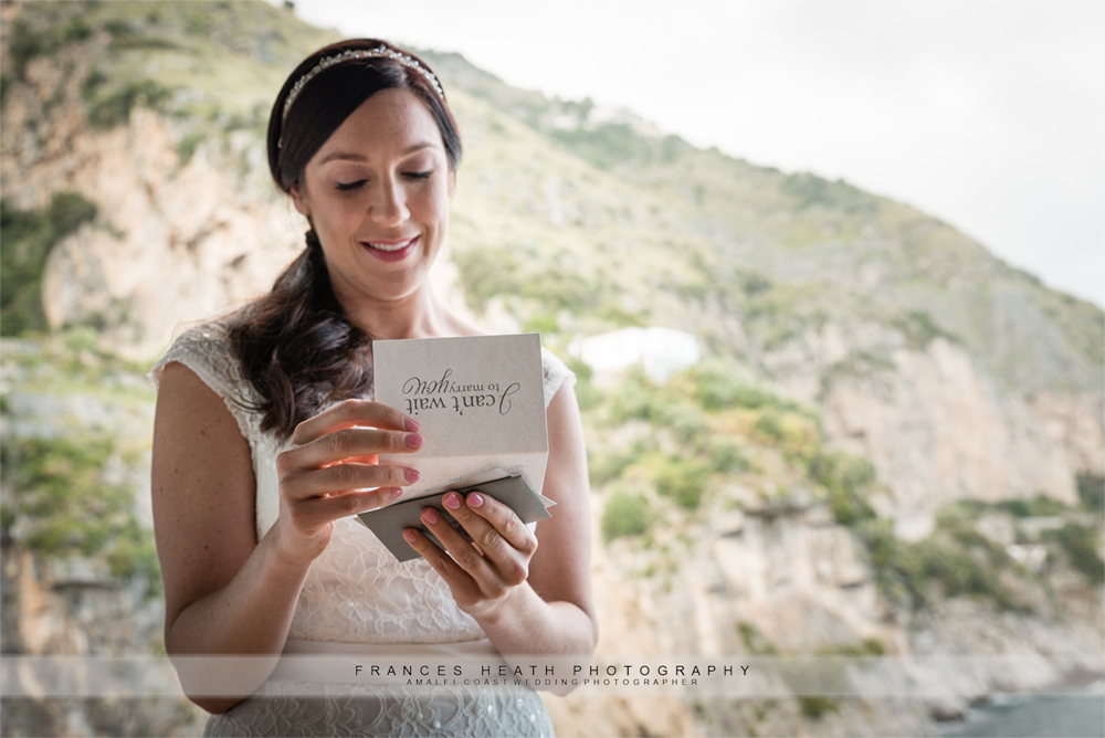 Bride reading wedding card