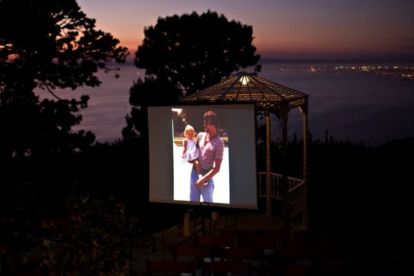 looping outdoor slideshow | vintage california chic wedding of Oh Lovely Day | Photo by Jennifer Roper