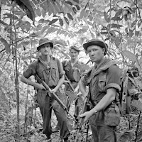 A British patrol of three soldiers in the jungle of Malaya in the 1950s.