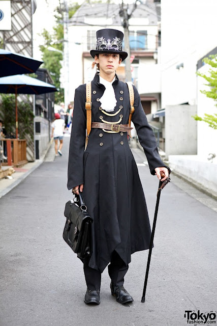 Men's Steampunk Fashion: Harajuku Aristocrat. Wealthy upper class steampunk character, part of the aristocracy, a lord. Long coat, top hat, mask, cane, leather bag.