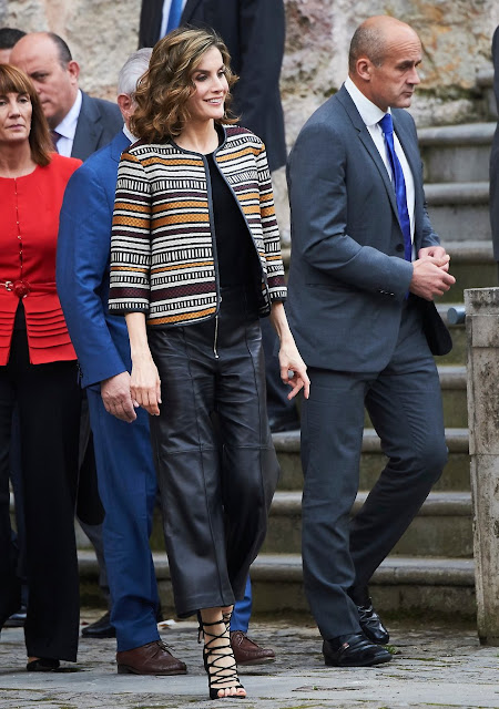 Queen Letizia of Spain attends the opening of the 11th International Seminar on Language and Journalism. Letizia wore Uterque Coat, Leather Trouser and Sandals