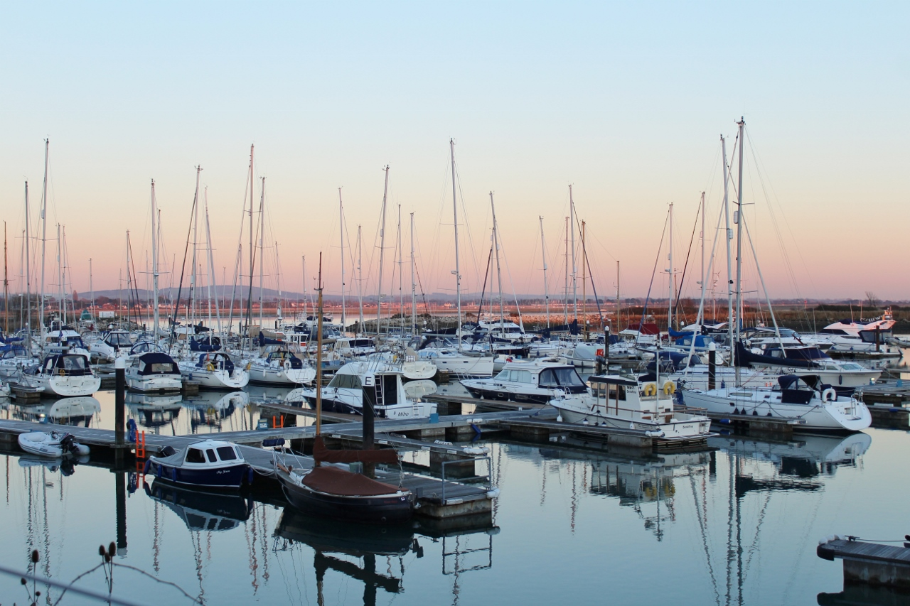 Sailing boats in harbour at sunset - photography for downtime