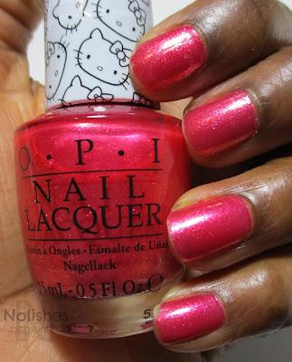 Swatch of OPI 'Say Hello Kitty', shimmery pink nail polish