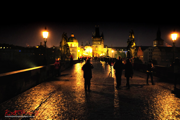 The Charles Bridge at night spring rain. Prague by Travel and Lifestyle Photographer Kent Johnson.