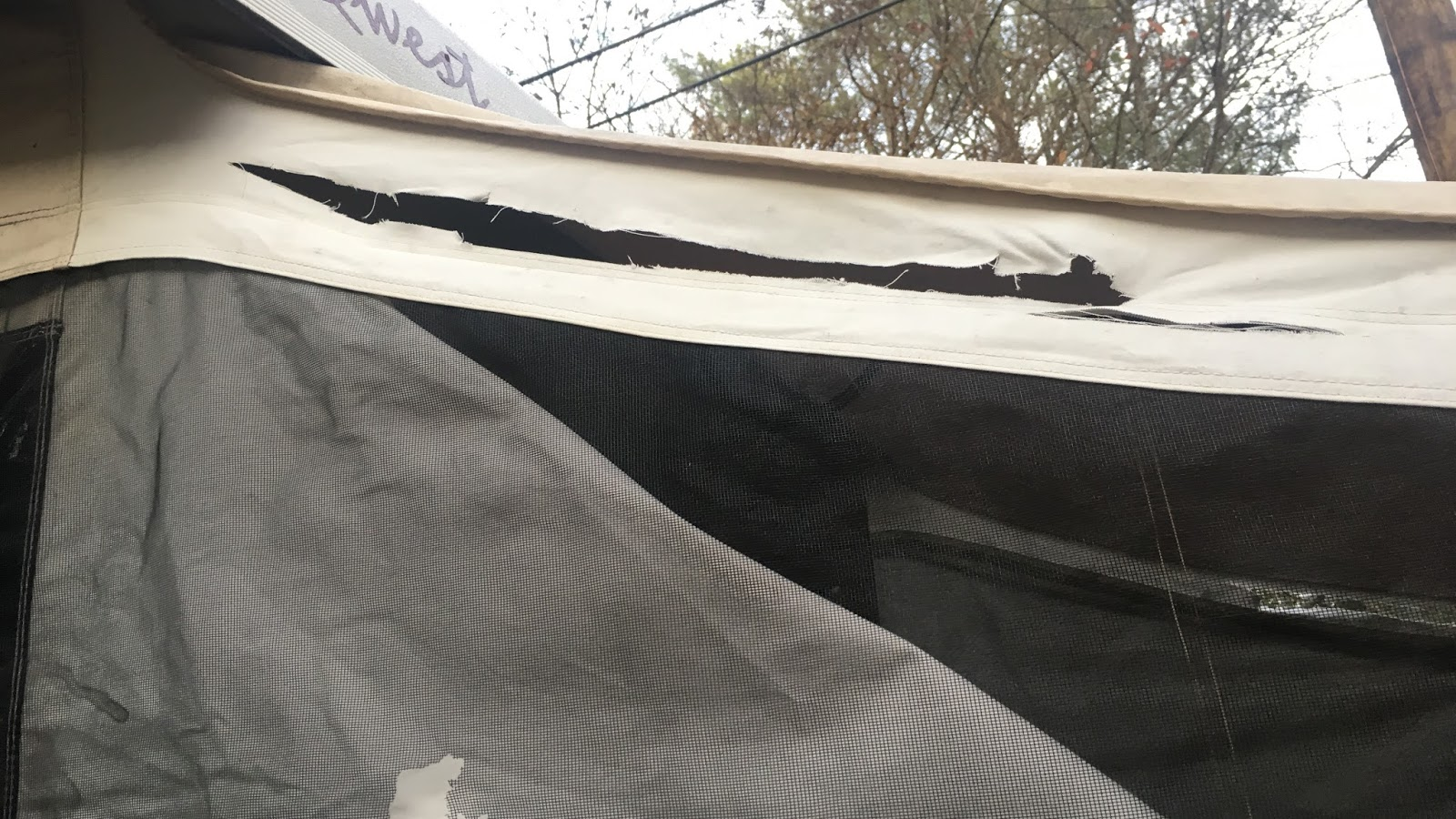 So I opted to use the canvas repair kit. I glued a piece of cut canvas repair fabric on both the interior and exterior of the c&er. & The Southern Glamper: How to Repair Torn Canvas on a Pop Up Camper