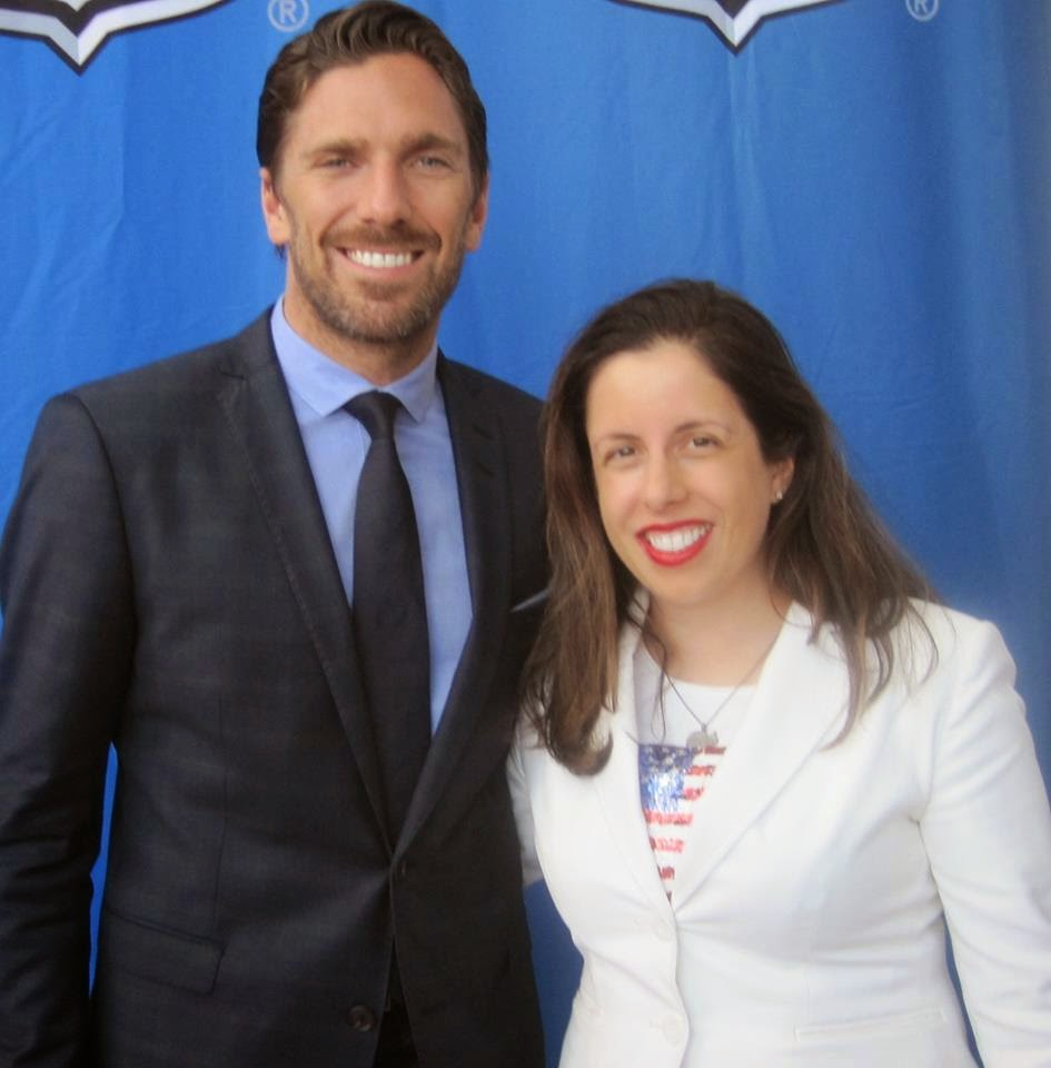Henrik Lundqvist of the New York Rangers with Peachy Deegan