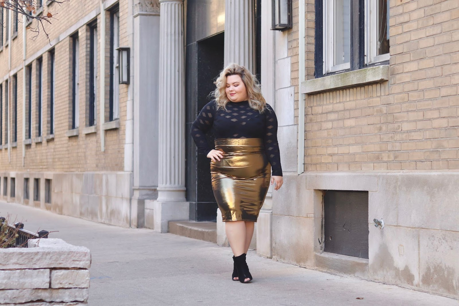 Chicago Plus Size Petite Fashion Blogger and model Natalie Craig reviews Fashion Nova Curve's Edges That Scratch Bodysuit and Heart of Gold Midi Skirt. Plus size New Years eve outfits 2019