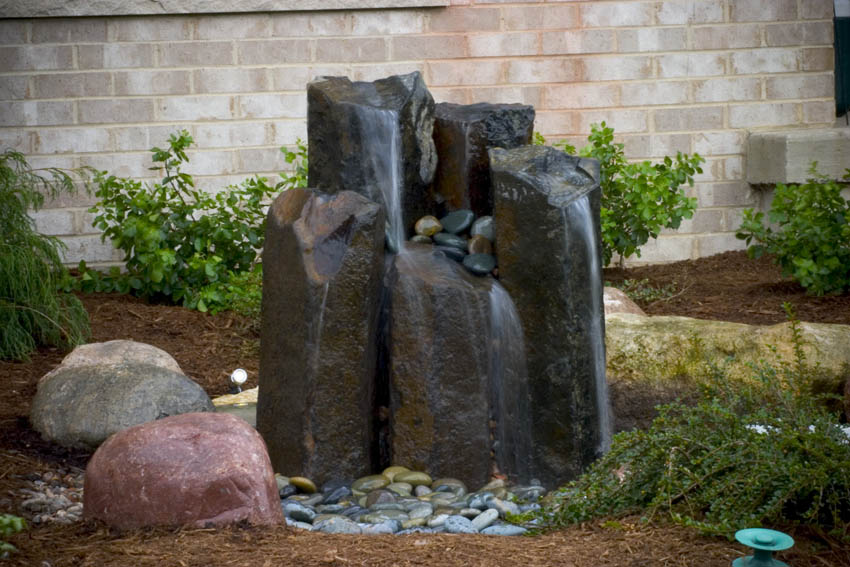 Beautiful A Grouping Of Fountain Rocks Greets Visitors Near The Homeu0027s Front Door. An  Underground Basin Holds Water That Is Circulated By A Pump Up Through The  Rocks, ...