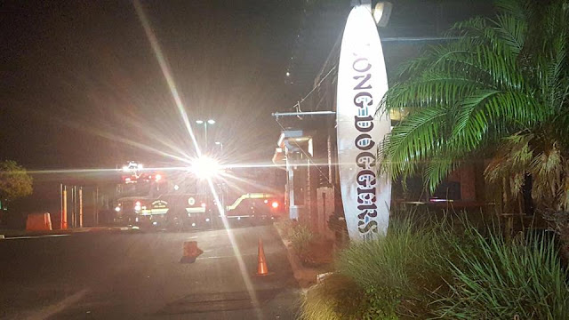 A patrol officer saved Long Doggers restaurant from a fire in Palm Bay.