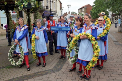 Picture: Some of those who took part in the annual Blessing of the Pumps ceremony in Brigg town centre where two of the old cast iron water suppliers have been preserved - see Nigel Fisher's Brigg Blog