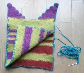 Blanket stitch both sides.