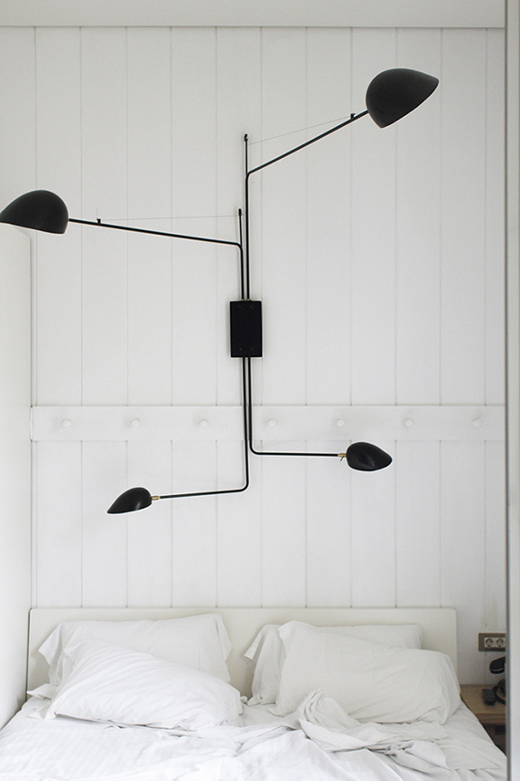 High-impact things to hang over your headboard | Oversized swing arm wall sconce. Hotel Praktik Metropol Madrid