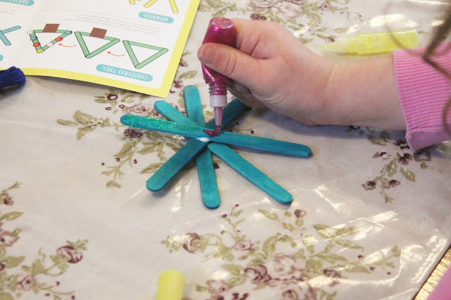 child decorating icicle christmas craft