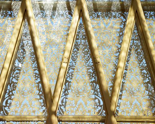 Tinuku Airmas Asri apply Balinese carvings and paintings on facade GRC material at Ananta Legian Hotel