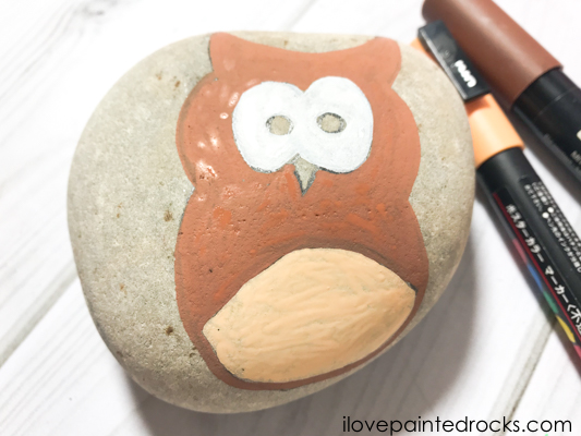 painting the owl's tummy when creating an owl painted rock