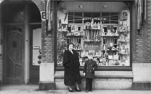 woman and boy outside a storefront