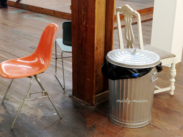 orange chair and a little trash for company - marty mason