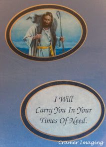 Cramer Imaging's photograph of a religious picture and a saying in a double circular double layer blue mat