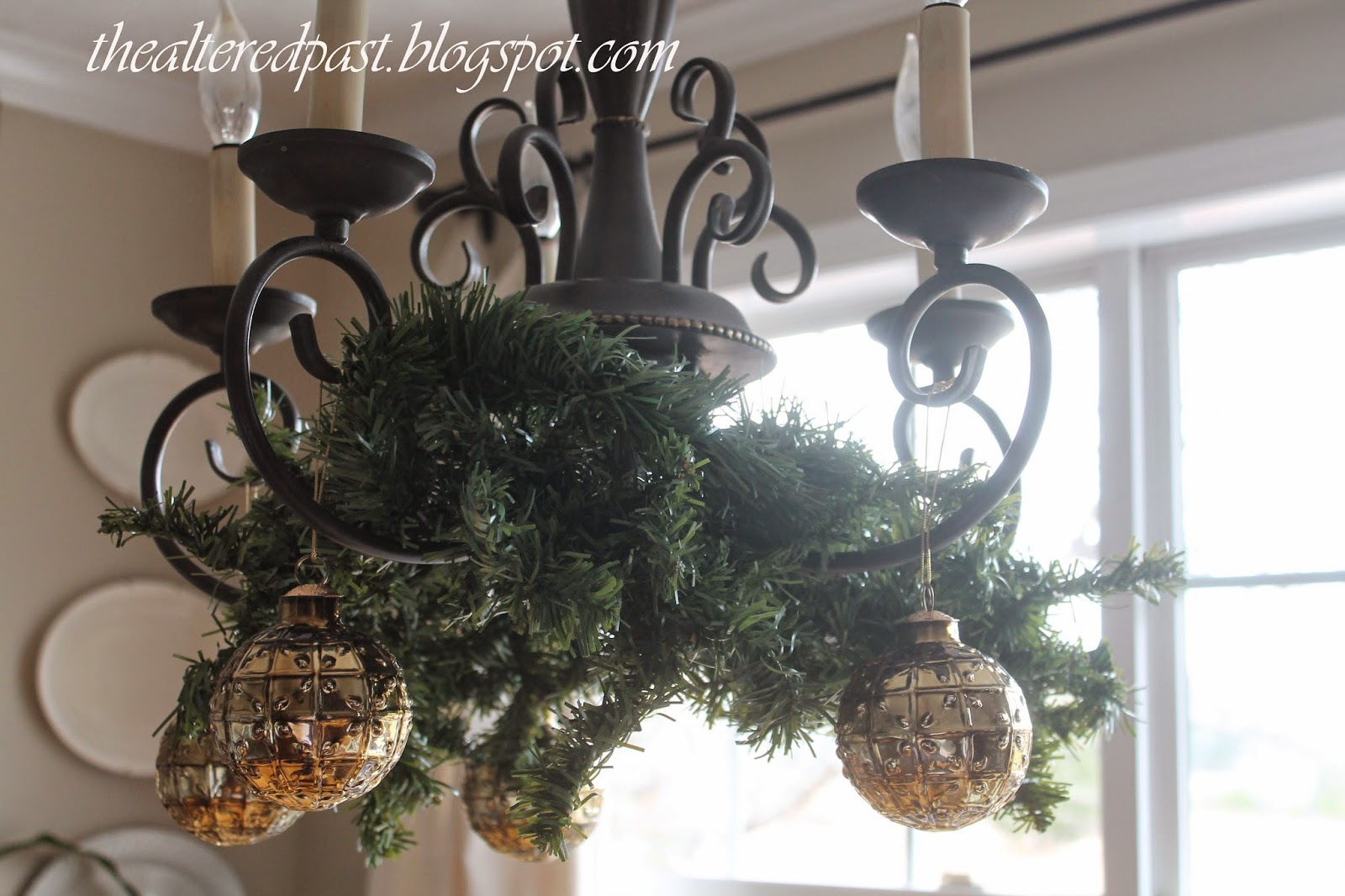 christmas home decor, greenery and gold balls on chandelier, the altered past