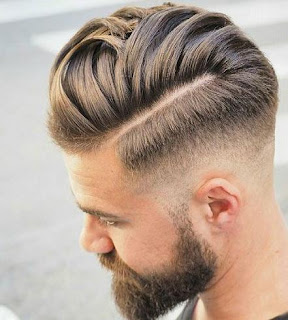 Low fade haircut with comb over