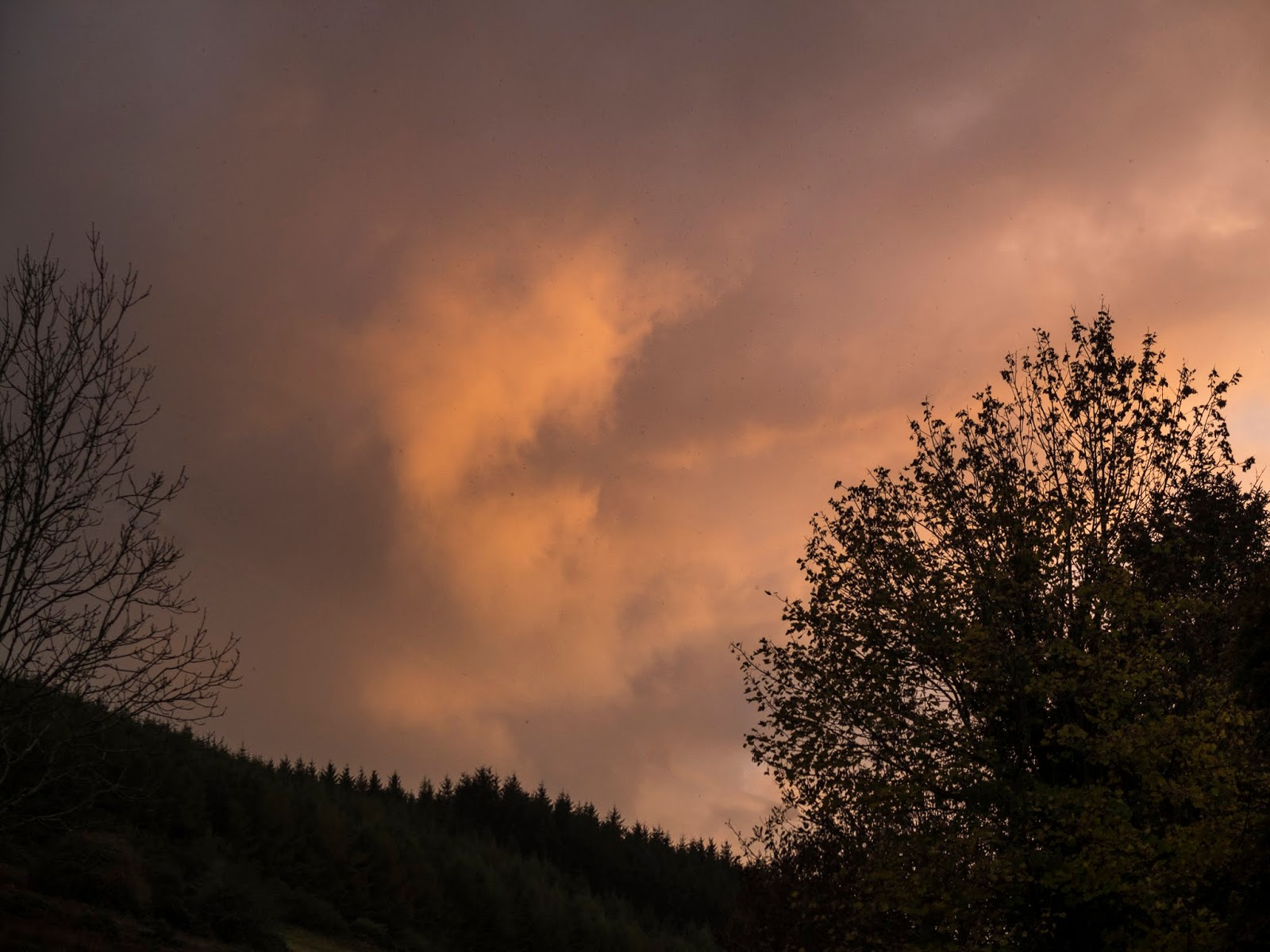 Autumn sunset clouds over a mountain side in North County Cork.