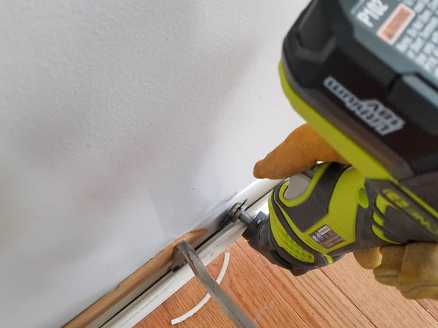 Ryobi multitool with metal blade to cut throw nails holding baseboards in place