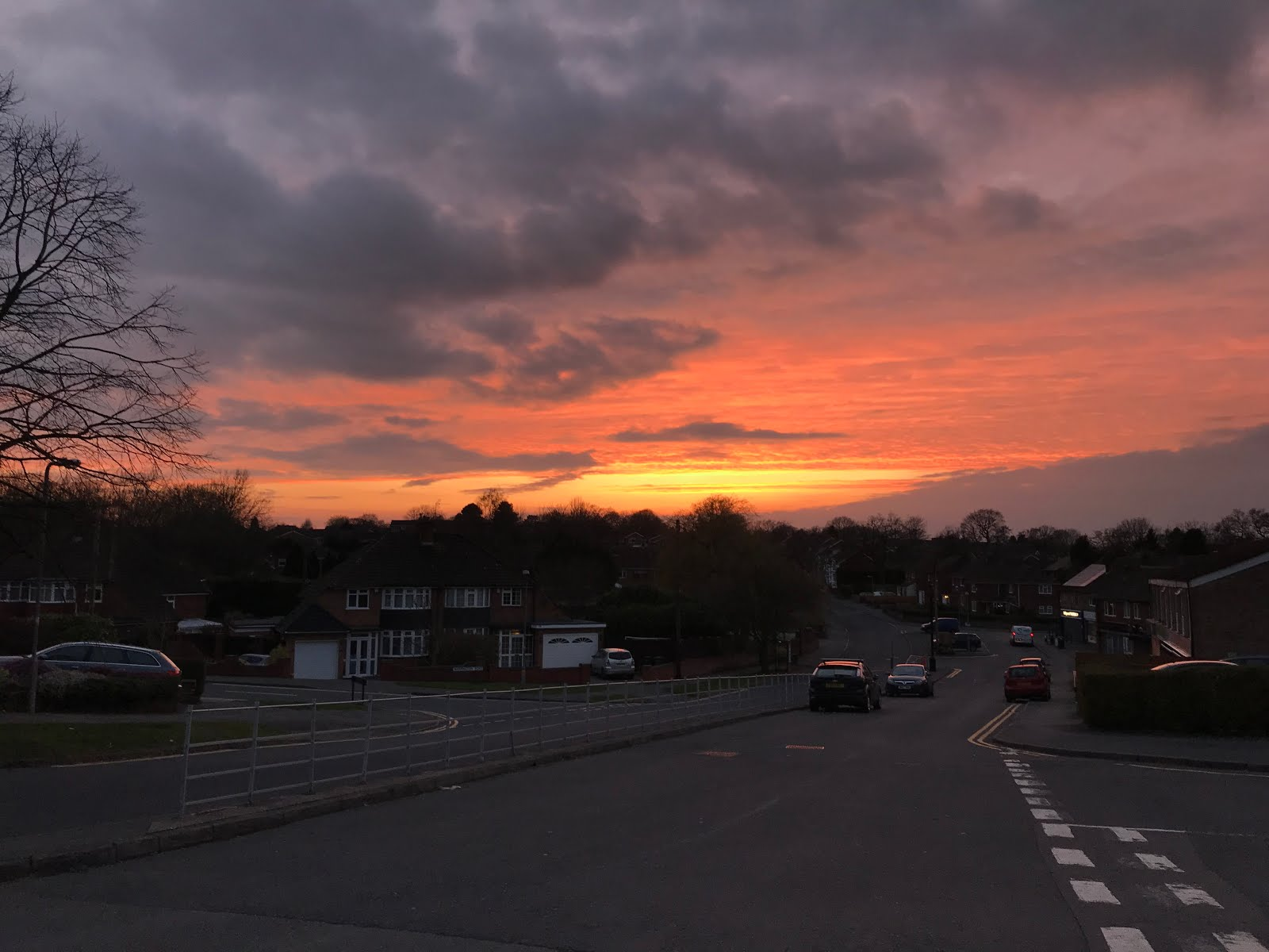 A sunset over houses in Wythall