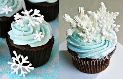 cupcakes decorated with pale blue icing with snowflakes placed on top