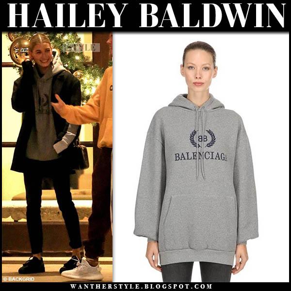 Hailey Baldwin in grey balenciaga hoodie, black pants and black adidas sneakers model off duty style january 2