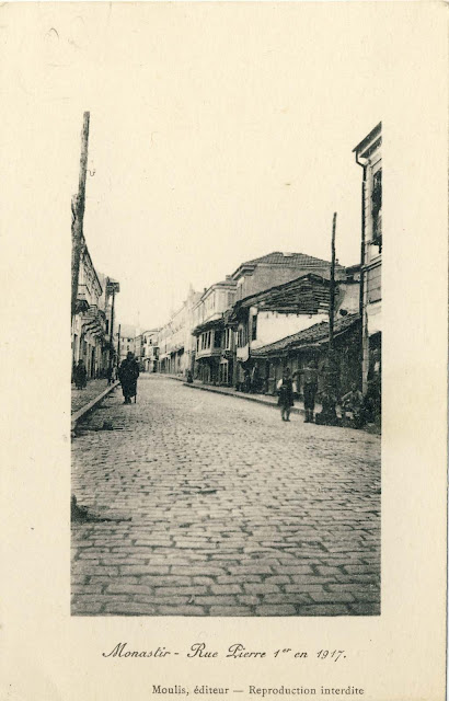 "Sirok Sokak street - ""King Peter"" in 1917. On the left is the hotel ""Balkan"" and on the right in the middle of the picture, is the Catholic Church. Publisher: Moulis, France On this postcard can be seen the new look of the street with large granite blocks, paved in 1913, which replaced the old Turkish cobblestones. In the mid seventies these granite blocks were replaced with asphalt, and later the entire main street (Sirok Sokak) got it today's look with granite slabs."