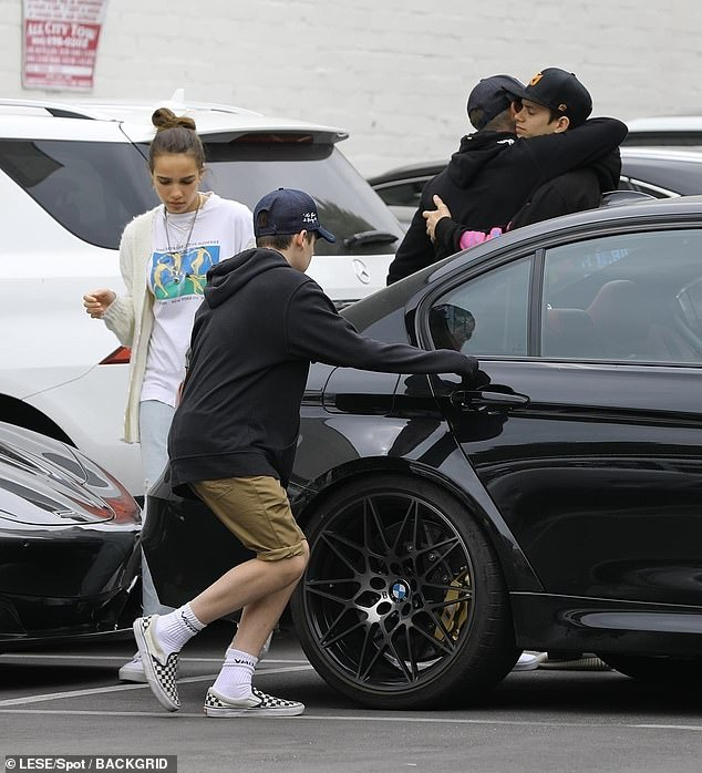 David Beckham gives son Brooklyn's girlfriend Hana Cross a friendly hug