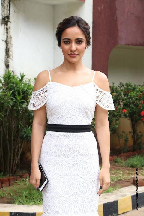 Neha Sharma in lovely Sleeveless White Dress at Solo Tamil Movie Press meet
