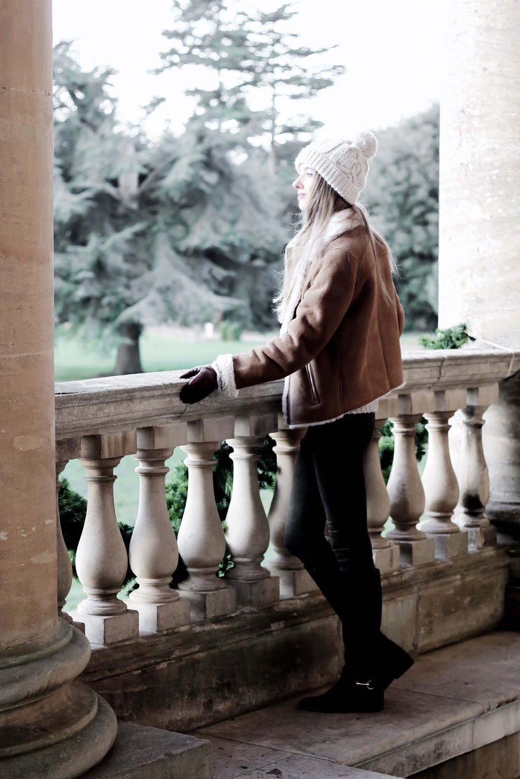 Fashion Blogger Styling Tan Sheepskin Jacket in Winter