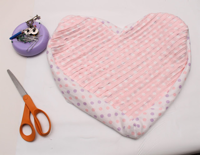 Heart pillow with sewing supplies