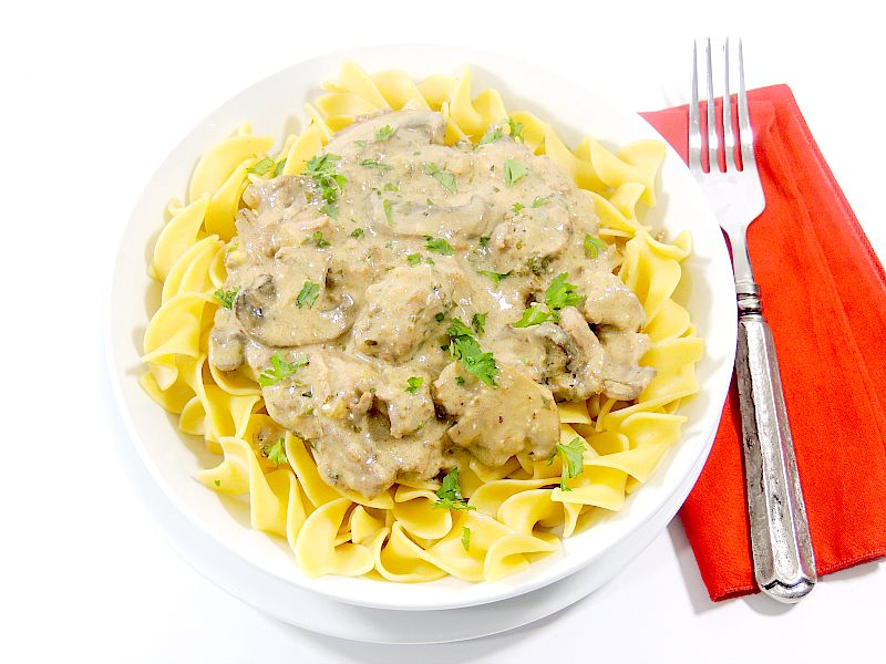 This Slow Cooker Beef Stroganoff recipe has creamy bites of beef, with earthy mushrooms, and is made ultra luxurious with the addition of port wine. It blows all other beef stroganoff recipes away! #beef #slowcooker #onepot #crockpot #recipe | bobbiskozykitchen.com
