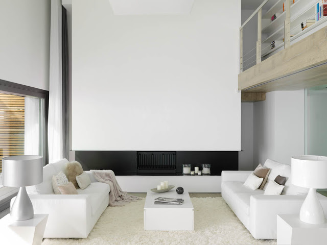 Two white sofas by the fireplace