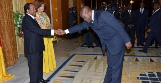 Cameroonians mock Minister with #BidoungChallenge after he greets their president too 'respectfully' (photos)