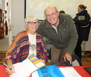 Barbara Curtis signing a copy of her book for Wessel Swanapoel