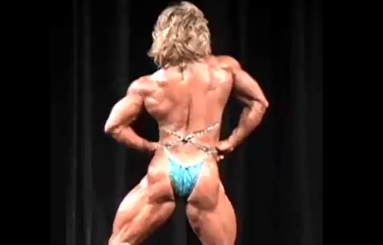 Video Female Bodybuilder muscle Poledancer flexing biceps