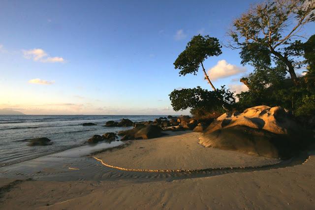 small river crosses the beach