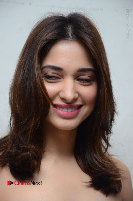 Actress Tamanna Latest Images in Floral Short Dress at Okkadochadu Movie Promotions  0002.JPG