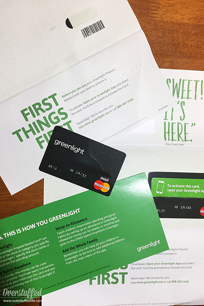 Greenlight the Smart debit card for kid comes in the mail and is ready to be activated and used by kids.