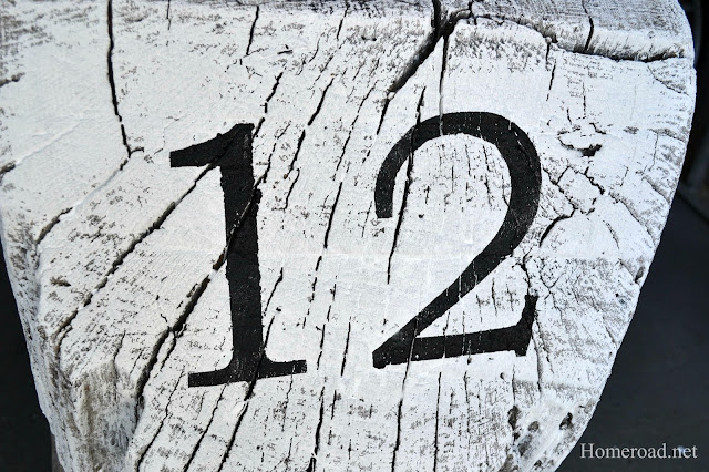 stenciled number 12 on stump