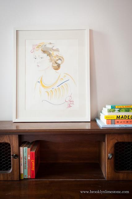 Watercolor on brown vintage desk in girl's bedroom